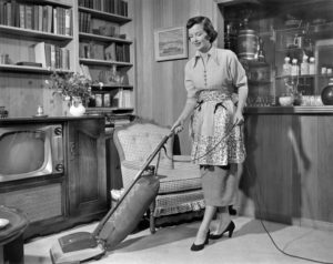 Vintage Homemaker vacuuming